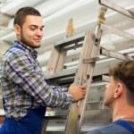 Two workers choosing PVC window profile — Stock Photo #72175913