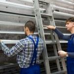 Two workers choosing PVC window profile  — Stock Photo #72175937