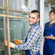Two  workers working with glass — Stock Photo #72176033