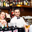 Friendly people working in popular bar — Stock Photo #72179215