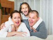 Little girl with happy parents — Stock Photo