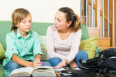 Mother explaining son  homework — Stock Photo