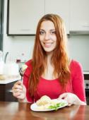 Woman eating potatoes — Stock Photo