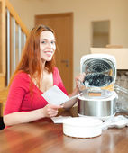 Housewife unpacking new multicooker — Stock Photo