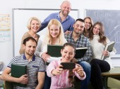 Professionals and coach making group portrait — Stock Photo