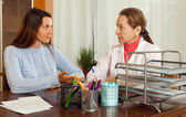Sick teenager complaining  to  doctor — Stock Photo