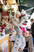 Happy family of four at Christmas market — Stock Photo