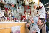 Parents with kids at  X-mas market — Stock Photo