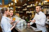 Girls flirting with handsome barman — Stock Photo