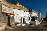 Dwellings houses-caves built  into rock. — Stock Photo