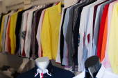 Fashionable apparel store with  shirts — Stock Photo