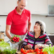 Senior man and mature woman  cooking  lunch — Stock Photo #75034601