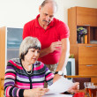 Mature couple calculating family budget — Stock Photo #75034949
