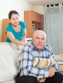 Upset senior man with  wife at home — Stockfoto