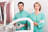 Happy dentist and head nurse — Stock Photo