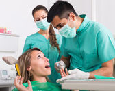 Doctor and frightened patient at  clinic — Stock Photo