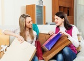 Girls together looking purchases — Stock Photo