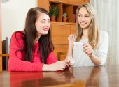Smiling women with pregnancy test — Stock Photo