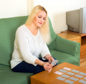 Woman playing solitaire at home — Stock Photo