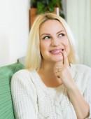 Woman having cunning look indoors — Stock Photo
