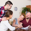 Two couples discussing and smiling — Stock Photo #75043503