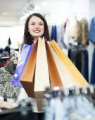 Girl with bags at store — Stock Photo
