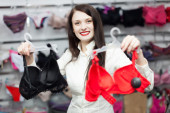 Buyer choosing bra at clothing store — Stock Photo