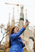 Woman  with digital camera photographing — Stock Photo