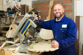 Woodworker on lathe in workroom — Stock Photo