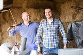 Two farmers working in barn — Stock Photo