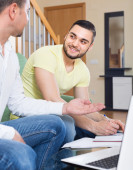 Two adult men with laptop indoor — Stock Photo