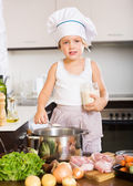 Girl cooking soup in pan — Stock Photo