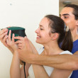 Couple making repairs in the apartment — Stock Photo #75050931
