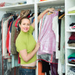 Female choosing apparel at store — Stock Photo #75051931