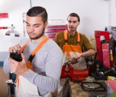 Two workmen toiling in workshop — Stock Photo