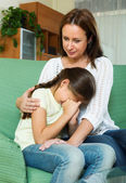 Woman comforting sad  crying daughter — Stock Photo