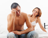 Man has problem, wife comforting him — Stock Photo