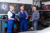 Auto service crew near tools — Stock Photo
