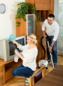 Family couple cleaning at home — Stock Photo