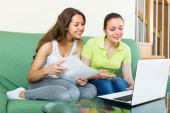 Women with laptop in home interior — Stock Photo