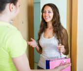 Girl visiting sister with birthday present — Stock Photo