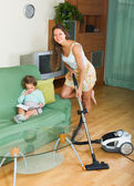 Family cleaning home with vacuum cleaner — Stock Photo