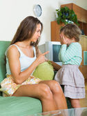 Woman scolding child at home — Stock Photo