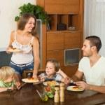 Family eating spaghetti — Stock Photo #75060219