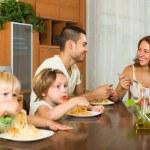 Family eating spaghetti — Stock Photo #75060243
