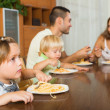 Family eating spaghetti — Stock Photo #75060245