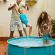 Family having fun in kids pool — Stock Photo #75060305