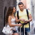 Couple with GPS navigator and baggage — Stock Photo #75061103