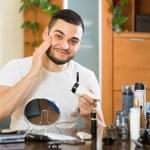 Man applying cream on face skin — Stock Photo #75062235