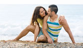 Loving pair on sandy beach — Stock Photo